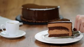 French mousse cake decorated with chocolate. Chocolate espresso mousse cakes with cocoa filling. stock video footage