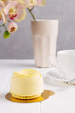 French mousse entremet with yellow chocolate velour Royalty Free Stock Images