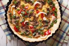 French mushroom quiche close-up on the table. horizontal top vie Stock Photography