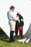 A French (Napoleonic) soldiers-reenactors puts a jacket on. Royalty Free Stock Photos