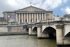 French National Assembly in Paris, France. The seine passing in front of the French National Assembly in Paris, France stock photo