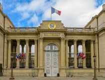 French National Assembly`s entrance monument in Paris, France. French National Assembly`s entrance monument with flags, columns, clock and lamp posts. Paris Royalty Free Stock Photography