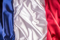 French national flag made up of three colorful satin fabric. Stock Photos