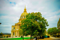 The French National Residence of the Invalids in Paris. During fall time with clouds in the background and good view of the building Royalty Free Stock Image