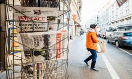 French newspaper kiosk selling diverse French newspapers. PARIS, FRANCE - DEC 10, 2018: Newspaper stand kiosk stand selling press with multiple newspaper royalty free stock photography