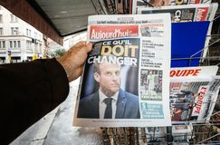 French newspaper kiosk selling man buy ppress featuring Emmanuel. PARIS, FRANCE - DEC 10, 2018: Newspaper stand kiosk stand selling press with man buying Aujourd royalty free stock photos