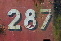 French numbers. Peeling paint, vintage sign Stock Photography