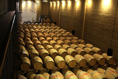 Wine Cellar. French oak wine barrels stored in the farms cellars stock image