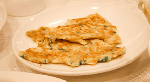 French omelet and eggs on the dish Stock Image