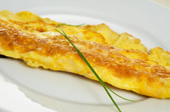 French omelette. Closeup of a french omelette, typical rolled plain omelette Royalty Free Stock Photo
