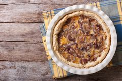 French onion pie on the table. horizontal view from above Royalty Free Stock Photo