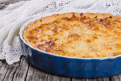 French onion quiche or pie in a gratin dish stock images