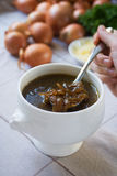 French Onion Soup. In a white bowl with ingredients in the background Royalty Free Stock Photos