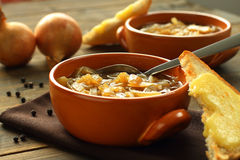 French onion soup. With cheese toast royalty free stock images