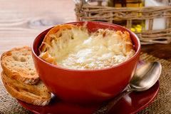 French onion soup with toasts on wooden table. Royalty Free Stock Image