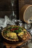 French opened pie quiche with tuna / chicken, broccoli, spinach, pepper, eggs, cheese and dried tomato. stock image
