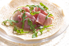 French pancake. With Italian ham and ruccola stock images