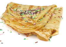 French pancake festive. Pancakes decorated withcolorful sugar confetti on white background stock image
