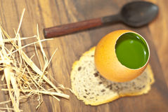French parfait with spoon. Overhead view of green parfait dessert on bread with spoon and straw; wooden background stock photos