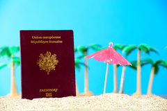 French passport in the sand of a beach Royalty Free Stock Images