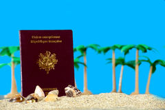 French passport in the sand of a beach Royalty Free Stock Photos