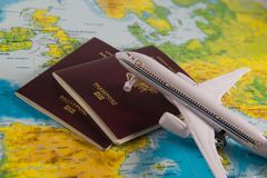 French passports on map and plane background Royalty Free Stock Photo