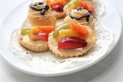 French pastry. Delicious french pastries on white plate Royalty Free Stock Photo