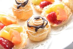 French pastry. Delicious french pastries on white plate Royalty Free Stock Images