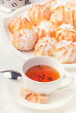 French pastry. Filled french pastries with tea Royalty Free Stock Image