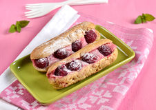 French pastry raspberry eclairs Stock Photography