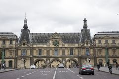 French people driving and biking with travelers walking and traffic road at front of Musee du Louvre. Or the Grand Louvre Museum on September 5, 2017 in Paris Royalty Free Stock Photos