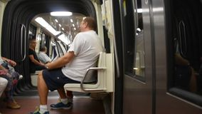 French people and foreigner travelers sitting inside of subway for journey around Paris city. Paris, France - September 6: French people and foreigner travelers stock video footage
