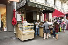 French people and foreigner travelers wait buying sweet snack Royalty Free Stock Photos