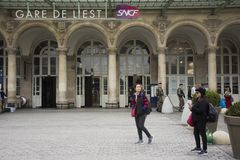 French people and foreigner travelers walking in and out at Gare de Paris-Est or Paris Gare de l`est railway station. Of Paris Metro on September 5, 2017 in Stock Image