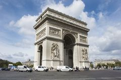 Arc de triomphe de l`Etoile or Triumphal Arch of the Star at Place Charles de Gaulle in Paris, France. French people and foreigner travlers walk visit Arc de Royalty Free Stock Image