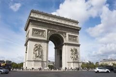 Arc de triomphe de l`Etoile or Triumphal Arch of the Star at Place Charles de Gaulle in Paris, France. French people and foreigner travlers walk visit Arc de Royalty Free Stock Photos