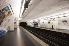 French people and foreigner travlers walk and wait train at underground subway station Royalty Free Stock Photography
