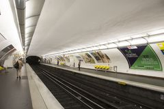 French people and foreigner travlers walk and wait train at underground subway station Stock Photography