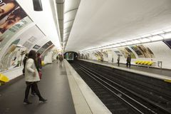 French people and foreigner travlers walk and wait train at underground subway station Stock Photos