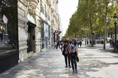 French people and foreigner travlers walking visit and shopping at sidewalk in L'avenue des Champs-Elysees. On September 6, 2017 in Paris, France royalty free stock photos