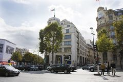 L'avenue des Champs-Elysees in Paris, France. French people and foreigner travlers walking visit and shopping at sidewalk in L'avenue des Champs stock photography