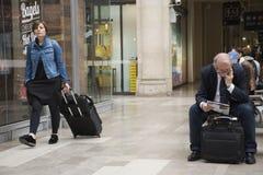 French people sit and wait and foreigner travlers walk  at Gare de Paris-Est or Paris Gare de l`est Royalty Free Stock Images