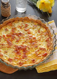 French pie, Quiche Lorraine. French pie Quiche Lorraine On the table with flower Stock Photos