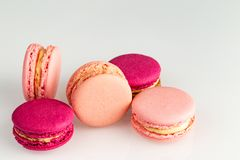 French pink and magenta macarons or macaroons stack, side top view on a white background. royalty free stock photos