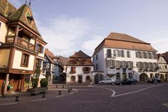 A french place - Alsace. Traditionnel view with several house, street and blue sky Stock Photo