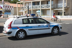 A French police car parked on a street corner Royalty Free Stock Image