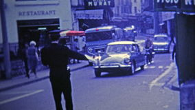 1969: French police direct traffic in the street with help of military. stock video