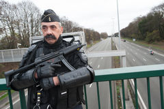 French police with gun at climate conference Royalty Free Stock Image