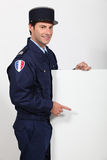French policeman with poster. Man dressed as policeman stood with poster Stock Photo