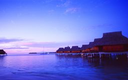 French Polynesia: Bora Bora Lagoon Resort at sunset royalty free stock photography